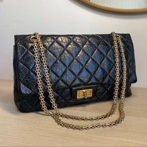 CHANEL 2.55 quilted black/gold double flap bag